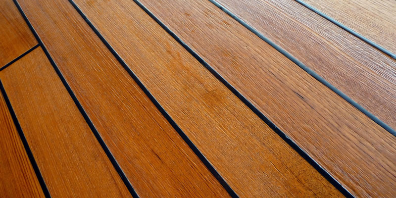 wet stained teakwood deck