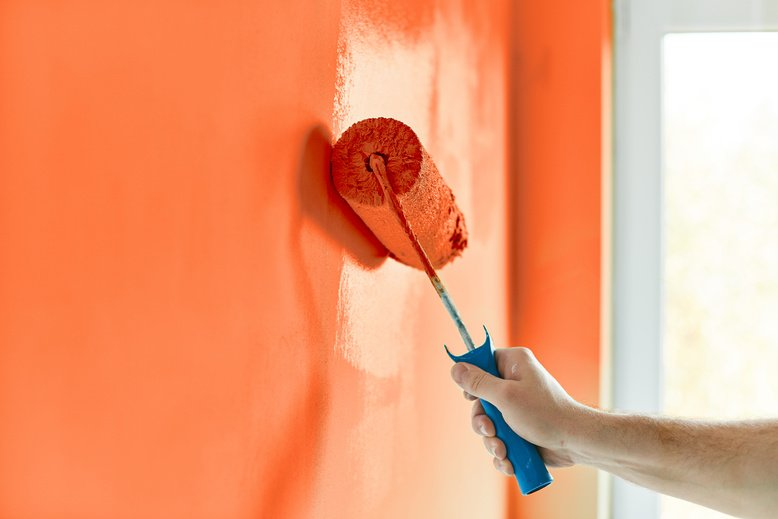 professional painter expertly painting home interior